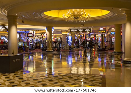 LAS VEGAS - FEBRUARY 15, 2014: A view of the Venetian casino from the lower level Palazzo walkway. - stock photo