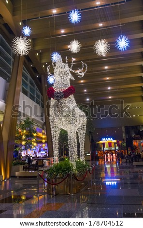 LAS VEGAS - JAN 13 : holiday light installation at Aria hotel in Las Vegas on January 13 2014. The Aria was opened on 2009 and is the world's largest hotel to receive LEED Gold certification - stock photo