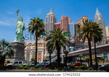 LAS VEGAS - JUL 16: New York-New York hotel with the Statue of Liberty and Excalibur hotel on Las Vegas Strip on July 16, 2013 in Las Vegas, Nevada.  - stock photo