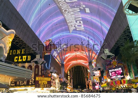 LAS VEGAS - JULY 28 : Fremont Street in Las Vegas, Nevada on July 28, 2011. The street is the second most famous street in the Las Vegas. Fremont Street dates back to 1905, when Las Vegas was founded. - stock photo