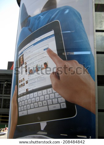 LAS VEGAS - JULY 10: IPad Ad featuring Facebook use on an outdoor Ad at Fashion Show Mall. July 10 2011 in Las Vegas, NV. - stock photo
