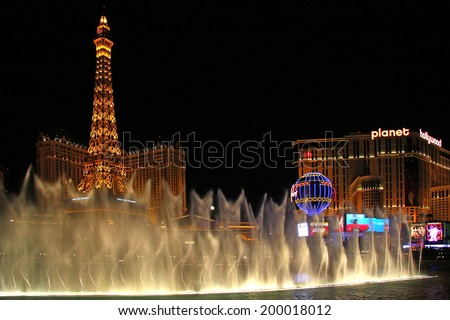 LAS VEGAS - JULY 27: The Paris Las Vegas hotel and casino on July 27, 2013 in Las Vegas. The Paris opened in 1999 and features a replica of the Eiffel Tower.  - stock photo