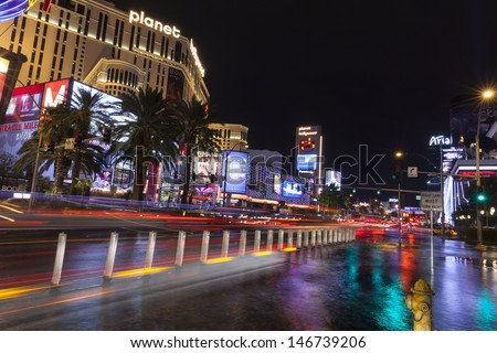 LAS VEGAS - JULY 19,  - Vegas Strip on July 19, 2013 in Las Vegas. Vegas hotels and cars make beautiful colors in the temporary lake formed by a storm on the Las Vegas strip.