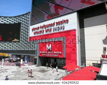 LAS VEGAS - JUNE 29: People enter and exit Planet Hollywood Hotel Miracle Mile shops on June 29, 2015 in Las Vegas. - stock photo