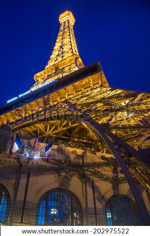 LAS VEGAS - JUNE 15 : The Paris Las Vegas hotel and casino on June 15 , 2014 in Las Vegas, Nevada, USA. It includes a half scale, 541-foot (165 m) tall replica of the Eiffel Tower.