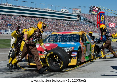 LAS VEGAS - MAR 10: Kyle Busch in for a pit stop at the Nascar Kobalt 400 in Las Vegas, NV on Mar 10, 2013 - stock photo