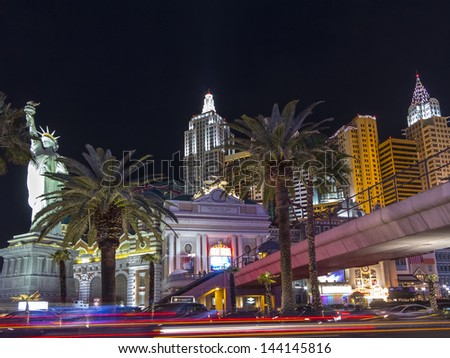 LAS VEGAS - MAR 11: New York-New York hotel casino which makes the New York City skyline with skyscraper towers and Statue of Liberty replica on March 11, 2013 in Las Vegas, Nevada. - stock photo