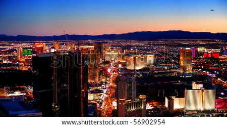 LAS VEGAS - MAR 4: Vegas Strip, 3.8 mile stretch featured with world class hotels and casino, aerial night view on March 4, 2010 in Las Vegas, Nevada. - stock photo