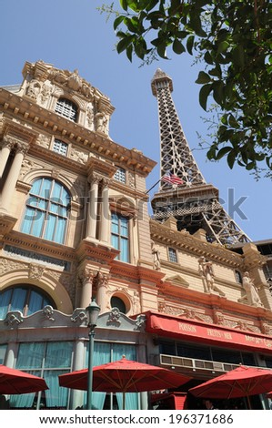 LAS VEGAS - MAY 10: A replica of the Eiffel Tower looms over the Paris hotel on May 10, 2010 in Las Vegas, Nevada, USA.