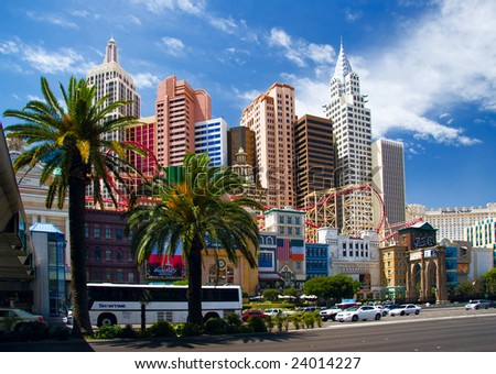 LAS VEGAS - MAY 2: Automobiles and tourist buses travel past the New York, New York Hotel & Casino on May 2, 2007 in Las Vegas. The hotel skyline architecture simulates the real New York City skyline. - stock photo