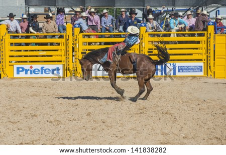 LAS VEGAS - MAY 17 : Cowboy Participant in a Bucking horse Competition at the Helldorado Days Professional Rodeo in Las Vegas , USA on May 17 2013 - stock photo