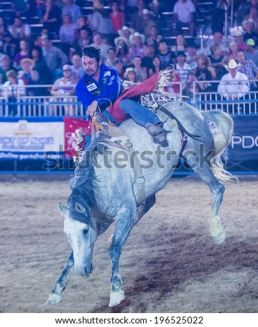 LAS VEGAS - MAY 16 : Cowboy Participating in a Bucking Horse Competition at the Helldorado days Rodeo , A Professional Rodeo held in Las Vegas on May 16 2014  - stock photo