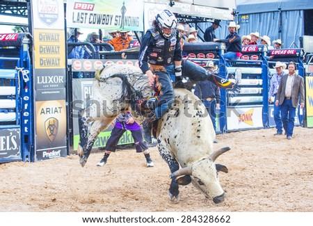 LAS VEGAS - MAY 23 : Cowboy Participating in a Bull riding Competition at the Las Cowboy Standing , a PBR cometition with the fifty of the top bull riders in the world held in Las Vegas on May 23 2015 - stock photo