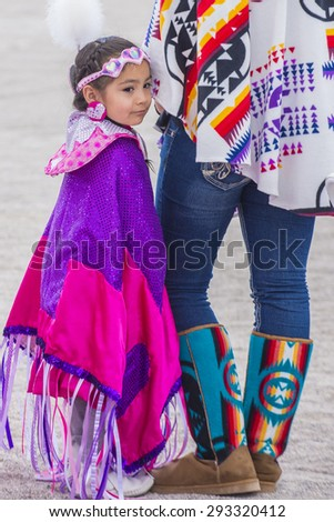 LAS VEGAS - MAY 24 : Native American girl takes part at the 26th Annual Paiute Tribe Pow Wow on May 24 , 2015 in Las Vegas Nevada. Pow wow is native American cultural gathernig event. - stock photo