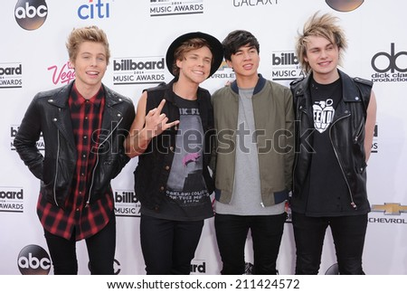LAS VEGAS - MAY 18:  5 Seconds of Summer arrives to the Billboard Music Awards 2014  on May 18, 2014 in Las Vegas, NV.                 - stock photo
