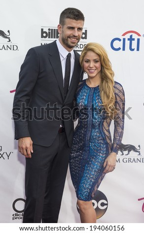 LAS VEGAS - MAY 18 : Soccer player Gerard Pique (L) and recording artist Shakira attends the 2014 Billboard Music Awards at the MGM Grand Garden Arena on May 18 , 2014 in Las Vegas. - stock photo