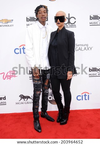 LAS VEGAS - MAY 18:  Wiz Khalifa & Amber Rose arrives to the Billboard Music Awards 2014  on May 18, 2014 in Las Vegas, NY                 - stock photo