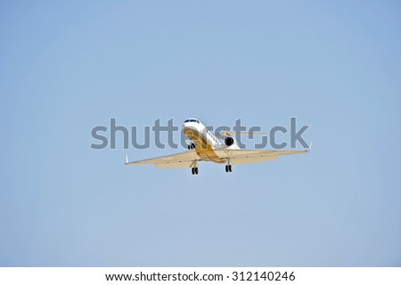 LAS VEGAS/NEVADA - AUGUST 20, 2015: Private Jet on approach to runway at McCarren International Airport in Las Vegas, Nevada USA