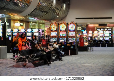 LAS VEGAS, NEVADA - DECEMBER 24: Slot machine in a public airport in Las Vegas, NV, on December 24, 2013. - stock photo