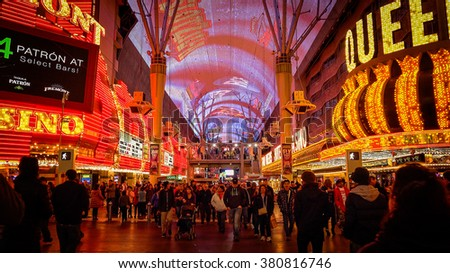 LAS VEGAS, NEVADA - FEBRUARY 5:  Bright neon lights and tourists at the Fremont Street Experience in Las Vegas, Nevada on February 5th, 2016. - stock photo