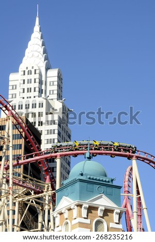 LAS VEGAS, NEVADA - JANUARY 1, 2015: Incredible view of the  Chrysler Building and Roller Coaster at the New York-New York Hotel and Casino from the strip on January 1, 2015.  - stock photo