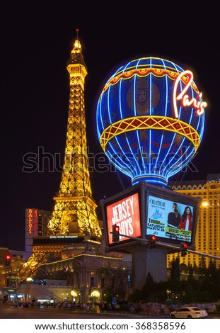 LAS VEGAS, NEVADA - MARCH 26: Eiffel Tower and Montgolfier balloon in Paris Las Vegas hotel and Casino in Las Vegas, Nevada at night on March 26, 2015.  - stock photo