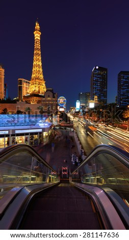 LAS VEGAS, NEVADA - MARCH 26: World famous Vegas Strip at night on March 26, 2015 in Las Vegas, Nevada. Vertical image. - stock photo