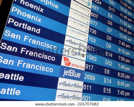 LAS VEGAS, NEVADA - MAY 22: Arrival display board at airport terminal showing destinations flights to some of the world's most popular cities in Mc Carran Airport, Las Vegas, Nevada on May 22, 2015. - stock photo