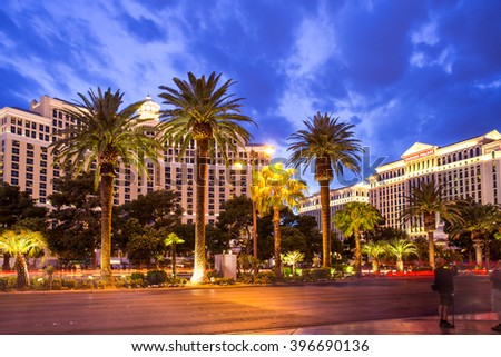 LAS VEGAS, NEVADA - MAY  7, 2014:  Evening view of Las Vegas Boulevard with hotels and palm trees with people visible.