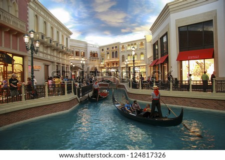 LAS VEGAS, NEVADA - MAY 4, 2009: Gondola trip indoors Venetian hotel in Las Vegas on May 4, 2009. The resort opened in 1999 and built at a cost of $1.5 billion - stock photo
