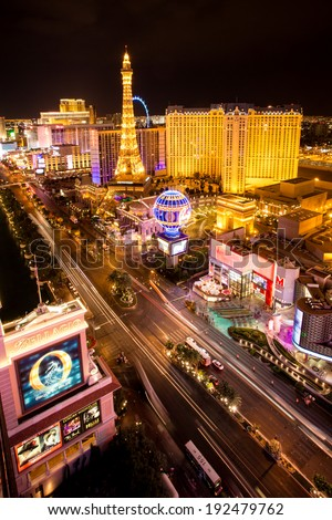 LAS VEGAS, NEVADA - MAY 7, 2014: Las Vegas Strip at night with brightly lit hotel resorts and casinos.  Over 39.7 million people visit Las Vegas each year. - stock photo