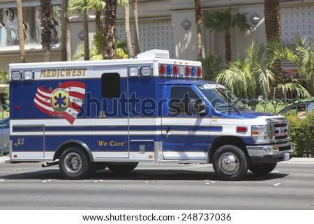 LAS VEGAS, NEVADA - MAY 9, 2014: Medic West Ambulance Truck on Las Vegas Strip. - stock photo