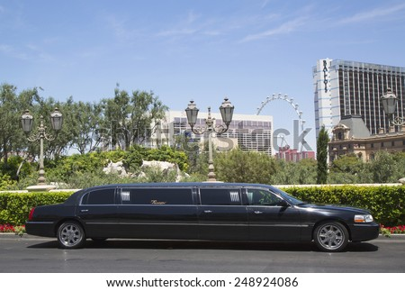 LAS VEGAS, NEVADA - MAY 9, 2014: Stretch limousine near Las Vegas Strip. The first stretch limousine was created in Fort Smith, AR around 1928 by a coach company named Armbruster - stock photo