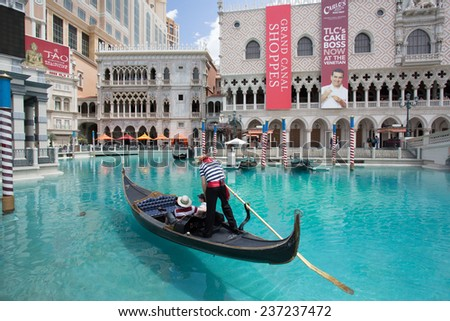 LAS VEGAS, NEVADA - MAY 7, 2014:  Venetian Palazzo Resort Casino with Grand Canal and gondola in view. This luxury hotel opened in 1999. - stock photo