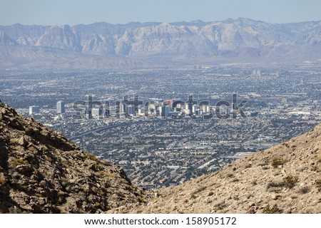 LAS VEGAS, NEVADA - Oct 15:  View of downtown Las Vegas.  Shot from Frenchman Mountain.  Vegas has 149,820 hotel rooms with a average daily rate of $110 on October 15, 2013 in Las Vegas, Nevada.  - stock photo