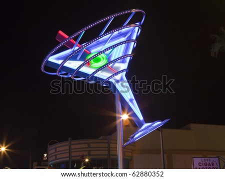 LAS VEGAS, NEVADA - OCTOBER 10:  Restored giant neon signs successfully attract tourists to the newly revitalizied Fremont Street East district in downtown, October 10, 2010 in Las Vegas, Nevada. - stock photo
