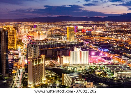 LAS VEGAS, NEVADA - SEPTEMBER 9: View of Las Vegas and the Las Vegas Strip from above on sunset on September 9, 2015. Las Vegas is known primarily for gambling, shopping and fine dining. - stock photo