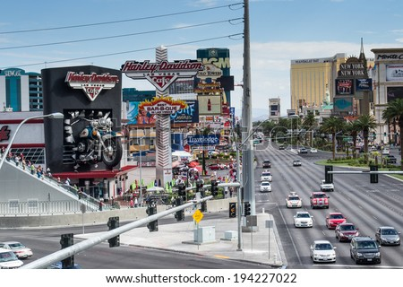 LAS VEGAS,NEVADA,USA-AUGUST,2 2012: people are walking and shopping along the famous strip of Las Vegas.In this picture you see the Harley Davidson cafe and souvenir shops. - stock photo