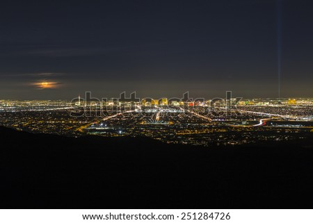 LAS VEGAS, NEVADA, USA - February 4, 2015:  Full moon rising over the city of Las Vegas in southern Nevada.   - stock photo