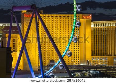 LAS VEGAS, NEVADA, USA - June 10, 2015:  Colorful lights on resort casino towers and High Roller ferris wheel on the Las Vegas strip. - stock photo