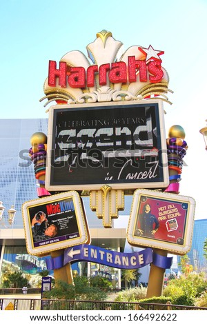 LAS VEGAS, NEVADA, USA - OCTOBER 20 : Harrah's Hotel and Casino Sign on October 20, 2013 in Las Vegas, Harrahs casino features over 1,200 slot machines, 80 table games, Keno, Bingo and a sports book. - stock photo