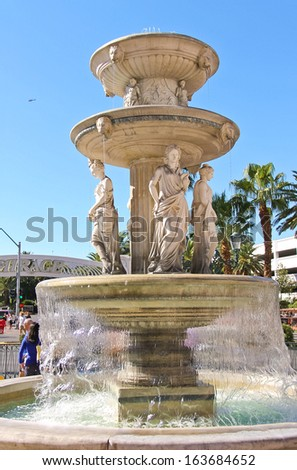 LAS VEGAS, NEVADA, USA - OCTOBER 20 : Italian-style fountain near  Venetian  Hotel on October 20, 2013 in Las Vegas, The resort opened on May 3, 1999. One of the most luxurious hotels in Las Vegas - stock photo