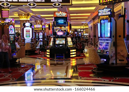LAS VEGAS, NEVADA, USA - OCTOBER 20 : Slot machines in the Palazzo Hotel on October 20, 2013 in Las Vegas, Palazzo opened on December 30, 2007. One of the most luxurious hotels in Las Vegas  - stock photo