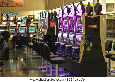 LAS VEGAS, NEVADA, USA - OCTOBER 20 : Slots in the airport McCarran on October 20, 2013 in Las Vegas, Nevada.  McCarran Airport has more than 1,234 slot machines throughout the airport terminals.  - stock photo