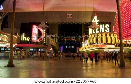 Las Vegas, Nevada, USA - September 24, 2014: Tourists enjoying the nightlife on the famous Fremont Street promenade Las Vegas, Nevada on  September 24, 2014.  - stock photo