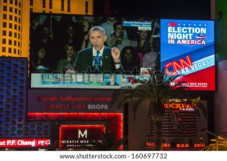 LAS VEGAS - NOV 07 : Election night in Las Vegas strip on November 07 2012 , CNN election broadcasts were projected on a giant screens  - stock photo