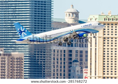 LAS VEGAS - NOVEMBER 3: Airbus A320 Interjet takes off from McCarran Airport in Las Vegas, NV on November 3, 2014. ABC Aerolineas, operating as Interjet, is a Mexican low-cost airline. - stock photo