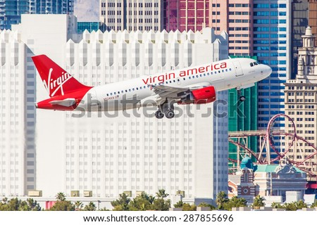 LAS VEGAS - NOVEMBER 3: Airbus A320 Virgin America takes off from McCarran Airport located in Las Vegas, NV on November 3, 2014. Virgin provides service between cities on the Eastern and West Coast. - stock photo
