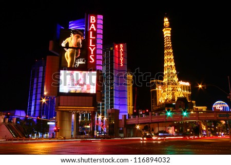 LAS VEGAS - NOVEMBER 30: Bally's Las Vegas and Paris Eiffel Tower Replica on November 30, 2011 in Las Vegas. Bally's is located on the Strip and has over 2,800 rooms available for guests. - stock photo