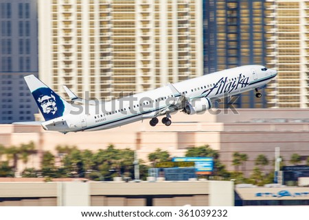 LAS VEGAS - NOVEMBER 7: Boeing 737 Alaska Airline takes off from McCarran in Las Vegas, NV on November 7, 2014. Alaska's route system spans more than 92 cities in United States Canada and Mexico. - stock photo